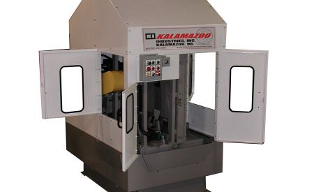 Enclosed abrasive saw captures particulates