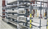 At Electralloy's new facility, a conveyor and racking system makes storing steel safer